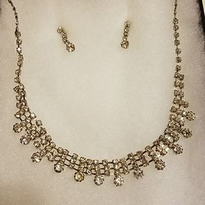 Silvertone and crystal necklace and earring set